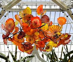 the blue sky garden chandelier by glass artist jamie barthel is a riot of colorful flowers each chandelier is hand painted reverse glass