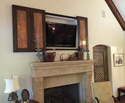 covering tv niche above fireplace ideas