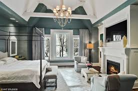 master bedroom. Plain Master The Master Suite Boasts A Green With White Accent Along Fireplace  Just Below Of To Master Bedroom