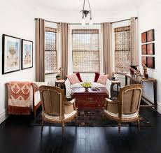 a coffee table or an extra seat if there s room you could work in an extra small scale chair or two across from the love seat in this arrangement