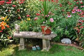 garden bench in colorful flower garden