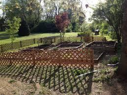 Repurposed Items A Garden Fence With Repurposed Items Kindcotton