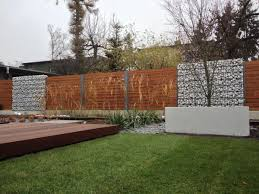 Image result for gabion and wood fence mixed