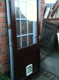 exterior wooden door with large glass panel and cat flap