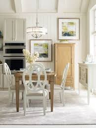rachael ray home everyday dining collection pieces shown in nutmeg and sea salt finishes legacy clic furniture
