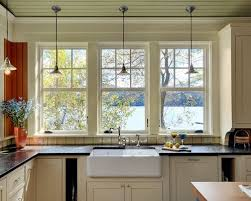 Inspiration For A Rustic Kitchen Remodel In Burlington With A Farmhouse Sink,  Beaded Inset Cabinets