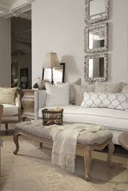 neutral living room with mirrors on wall
