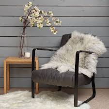 well that s where a sheepskin rug can come in handy as you simply throw it over the piece of furniture to transform it into a more comfortable seat