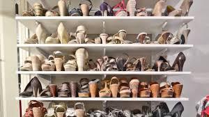 how to organize a woman s master closet shoe storage organizedliving com