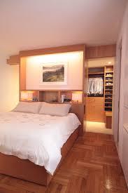 big walk in closet cool floor bed pillows impressive lighting clothes shoes modern bedroom