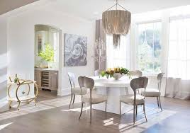 silver fringe chandelier over round white dining table