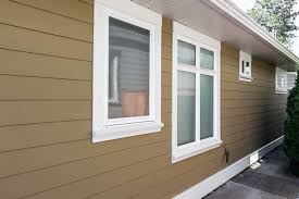painting exterior trim. hardie board siding painted golden colour with white trim work painting exterior a