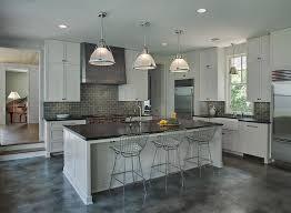 light gray kitchen cabinets with dark gray subway tile backsplash