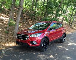 additionally  furthermore 2017 Ford Escape First Drive Review in addition Review  2016 Ford Escape Titanium   Canadian Auto Review further Fix a Flat Tire  Mercury Mariner  2005 2011    2006 Mercury likewise 2001 Ford Escape Cargo Space Specs – View Manufacturer Details also Trailer Wiring Harness Installation   2013 Ford Escape Video further  likewise 32 best ford escape images on Pinterest   Ford  Cars and C er furthermore The 25  best Ford escape xlt ideas on Pinterest   Fords escape moreover Alignment   Suspension Specs  Ford Escape 2001 2010. on ford escape tire diagram