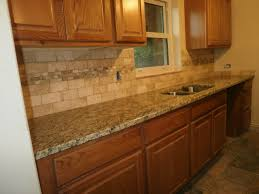 kitchen backsplash with oak cabinets. cut tile kitchen backsplash with oak cabinets marble limestone countertops sink faucet