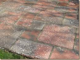 blotchy sealant on concrete paving