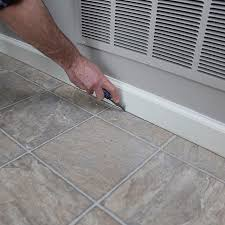 scoring around the floor perimeter with a utility knife