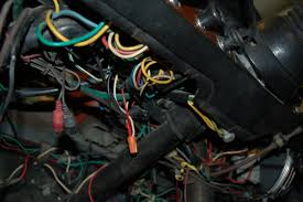 in our garage fixing decades of automotive wiring hacks under dash wires