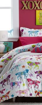 Horse bedding for little cowgirls who love pretty ponies. Girls western  bedding collection.