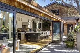 make the entrance to your patio a sliding glass wall