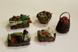 five neapolitan creche accessories depicting straw baskets with fruit and vegetables painted terracotta