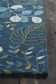 terra collection hand tufted area rug in blue cream green yellow design by chandra rugs french country