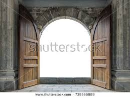 large wooden door open in rock castle wall 739566889