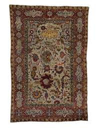 9 at sotheby s london s arts of the ic world auction on october 7 2009 this safavid silk wool and metal thread prayer rug was estimated at