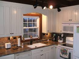 off white kitchen cabinets with antique brown granite picture