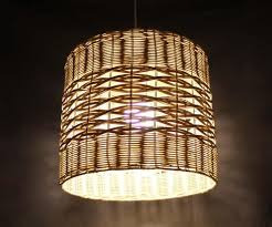 two diffe weaves light a rattan lamp