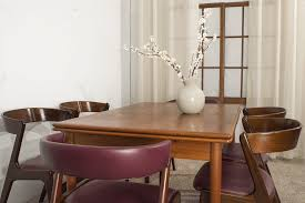 this set of kai kristiansen dining room chairs comprises two end chairs with upholstered backs and