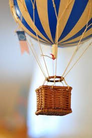 hot air balloon decoration from a vintage hot air balloon baby shower via kara s party ideas