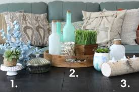 coastal coffee table display with 3 sets of decor