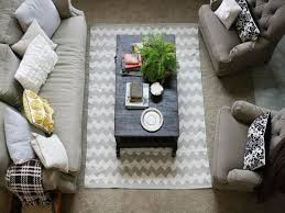 rug under coffee table. inexpensive rugs for living room using chevron area rug under black wood coffee table between english