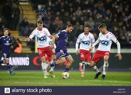 BRUSSELS, BELGIUM - NOVEMBER 24: Kemar Roofe of Anderlecht battles for the  ball with Andriy Batsula of