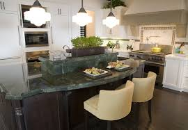 White Kitchen With Dark Kitchen Island With Green Top. The Island Is Split  Into Two