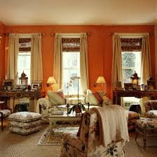 Orange And Brown Living Room Decor Living Room Orange Painting Wall Red Curtain Glass Windows