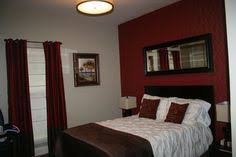 View in gallery Dark gray accent wall and pops of black anchor the lovely  room [Design: Epic