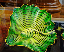 celtic emerald persian pair is among glass sculptures by artist dale chihuly in the