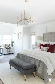 transitional master bedroom. Master Bedroom Decorating Ideas With Modern Brass Chandelier And White Walls Molding Transitional
