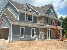 Exterior Charming White House Exterior Design Using Black Wood - Home exterior design ideas