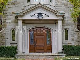 Elegant front doors Elegant Exterior Elegant Front Door With Stone Columns Melodywizclub Elegant Front Door With Stone Columns Buy This Stock Photo And