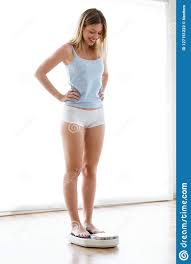 Healthy Young Woman, Happy To See That She Has Lost Weight On Scale Weight  At Home. Stock Photo - Image of choose, healthcare: 127151222