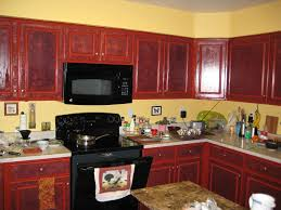 yellow concrete wall kitchen paint colors with cherry cabinets with cream granite top table combined with wooden cabinet can add the elegant touch inside