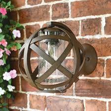 outdoor rustic metal globe wall lantern