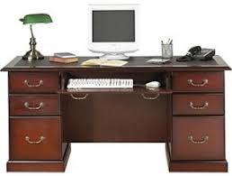 office desk staples. this executive desk has cherry finish and wood veneers two file drawers a keyboard tray comes ready to assemble office staples l