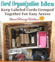 Organized cord storage drawer, with cables and cords labeled and separated  so they don' ...