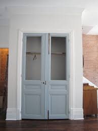 modern french closet doors. Modern Contemporary French Bifold Closet Doors With Brick Walls And Dark Wood Floor O