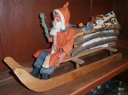 german large woodcutter santa in sleigh or sled with wooden toys