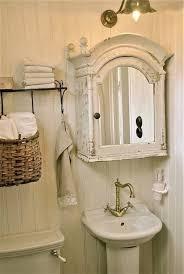 Ideas for half bath.antique medicine cabinet, hook rack with basket,  hanging soap dispenser